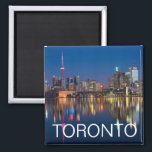 """Toronto, Ontario, Canada Evening Skyline Magnet<br><div class=""""desc"""">Enjoy a beautiful mini-view of Canada every day on your fridge. The glowing Toronto,  Ontario skyline is reflected in the lake in the evening. (Photo courtesy of Pixabay.)</div>"""