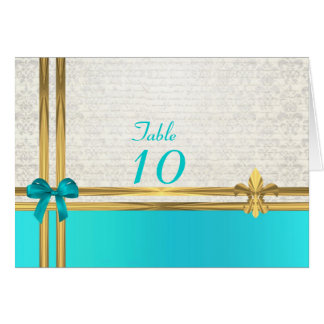 Torquoise and gold on white damask table number card