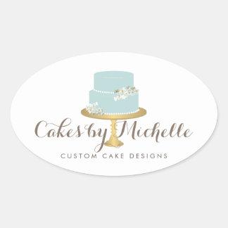 Torta azul elegante con la torta floral que adorna pegatina ovalada