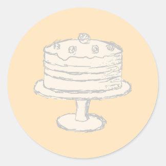 Torta del color crema en fondo beige pegatina redonda