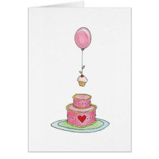 Torta rosada con el globo y la magdalena tarjetón