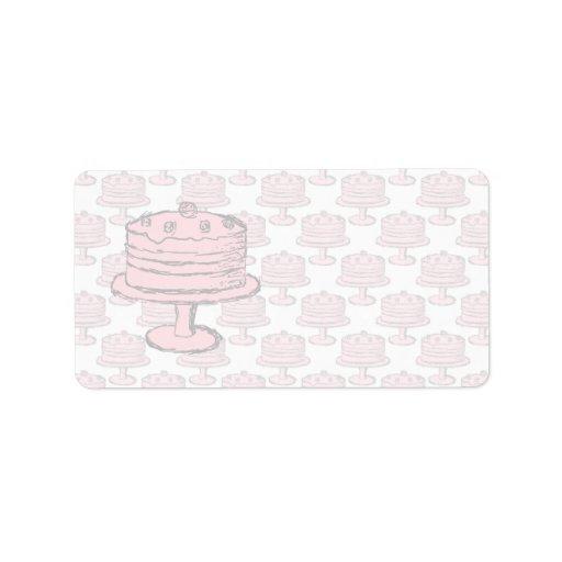 Torta rosada en modelo rosado de la torta etiqueta de dirección