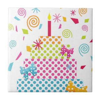 Torta y confeti del lunar azulejos