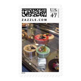 Tortas en ventana de demostración timbres postales