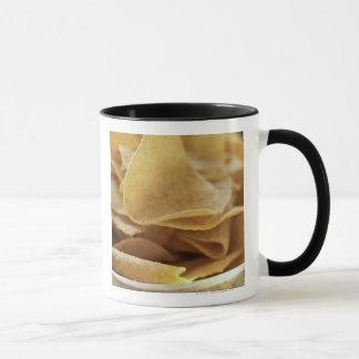 Tortilla chips in wooden bowl mug