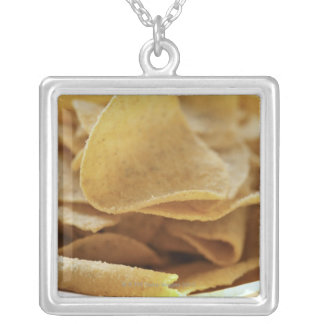 Tortilla chips in wooden bowl jewelry