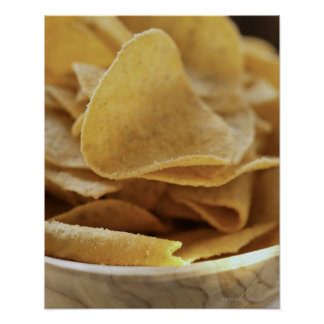 Tortilla chips in wooden bowl posters