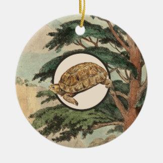Tortuga de desierto en el ejemplo del hábitat adorno navideño redondo de cerámica