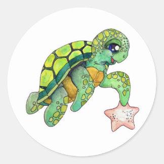 Tortuga de mar y estrellas de mar etiqueta redonda