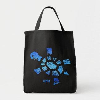Tortuga del agua azul bolsas de mano