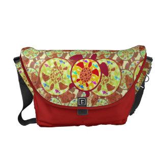 Tortuga dentro de la bolsa de mensajero de la tort bolsas messenger
