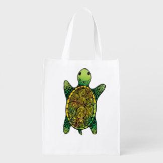 Tortuga dibujada tinta verde adorable de la bolsas para la compra