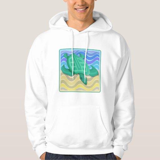 Tortuga en sudaderas con capucha de la playa