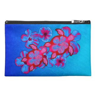 Tortugas de Honu y flores tropicales del hibisco