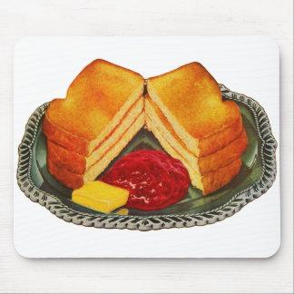 Tostada del kitsch del vintage, mantequilla y anun tapete de ratón