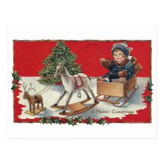 Tot Aboard Pretend Sleigh with Pretend Reindeer Postcard