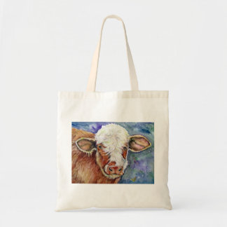 tote it  with a little cow style bag