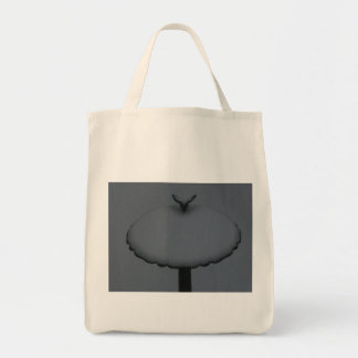 tote with snow capped bird bath