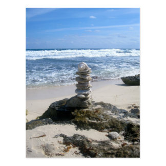 Totem on a secluded beach postcard