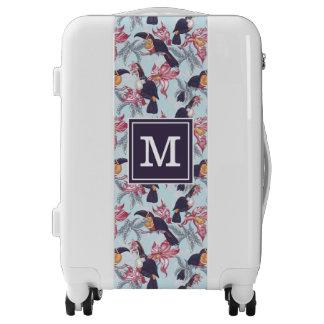 Toucans con el monograma exótico de las flores el maletas