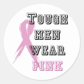 Tough men wear pink stickers