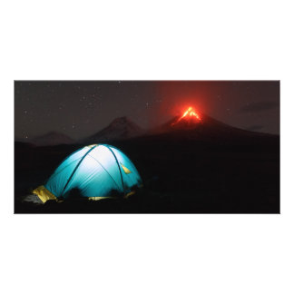Tourist tent at night on background of volcano card