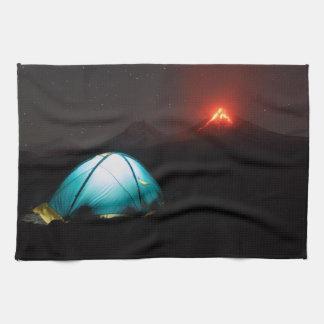 Tourist tent on background of erupting volcanoes towel