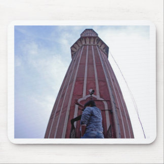Tourist waving to friend from minaret mouse pad