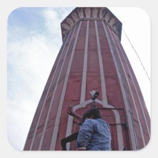 Tourist waving to friend from minaret sticker