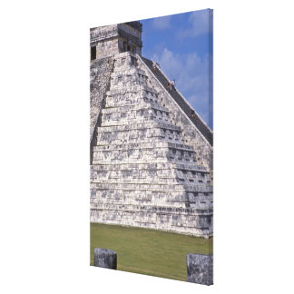 Tourists climbing stairs of El Castillo, stone Stretched Canvas Print