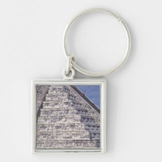 Tourists climbing stairs of El Castillo stone Keychains