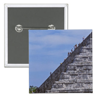 Tourists climbing stairs on ruins of El Button
