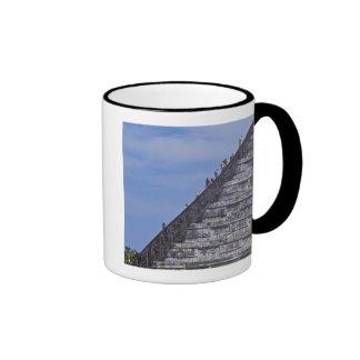 Tourists climbing stairs on ruins of El Ringer Mug