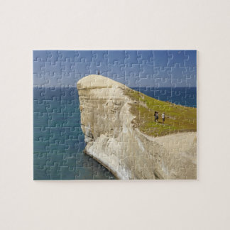 Tourists on cliff top at Tunnel Beach Jigsaw Puzzle