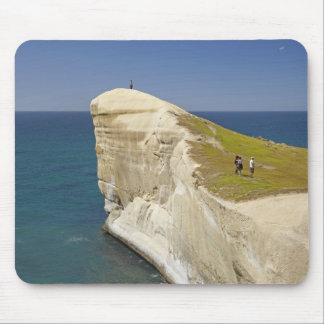 Tourists on cliff top at Tunnel Beach Mouse Pad
