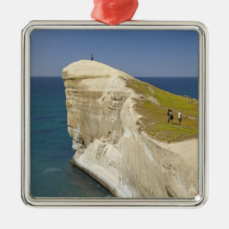 Tourists on cliff top at Tunnel Beach Square Metal Christmas Ornament