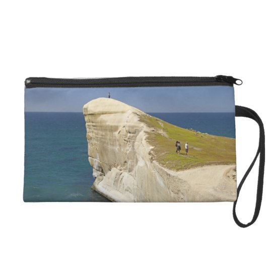 Tourists on cliff top at Tunnel Beach Wristlet