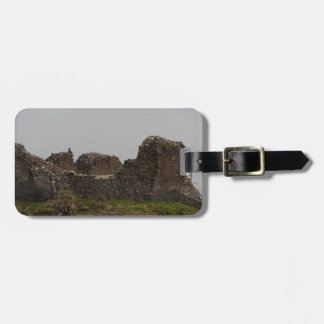 Tourists visible at the battered remains of castle luggage tag
