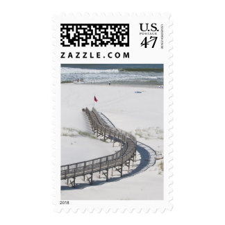 Tourists wade edge of surf postage