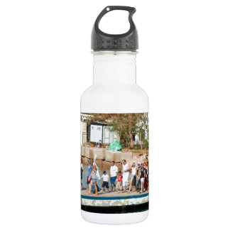Tourists waiting to climb into a boat water bottle