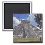 Tourists walk past an unrestored side of El 2 2 Inch Square Magnet