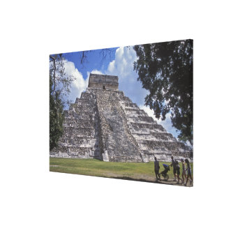 Tourists walk past an unrestored side of El 2 Canvas Print