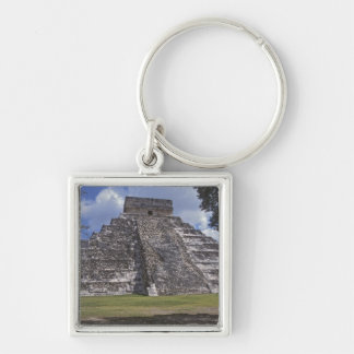 Tourists walk past an unrestored side of El Keychain