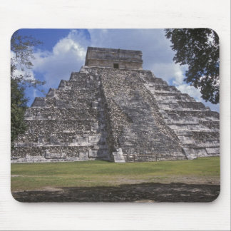 Tourists walk past an unrestored side of El Mouse Pad
