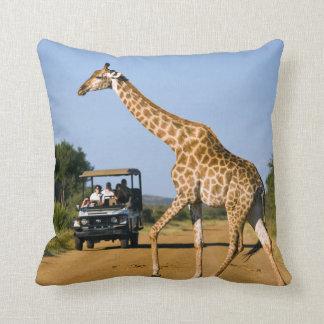 Tourists Watching Giraffe Throw Pillow