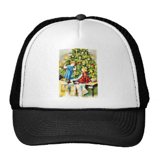 Tow kids playing under a christmas tree trucker hat