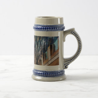 Towering cliffs and houses beer stein