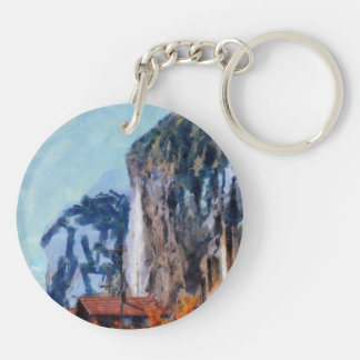 Towering cliffs and houses Double-Sided round acrylic keychain