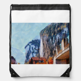 Towering cliffs and houses drawstring bag