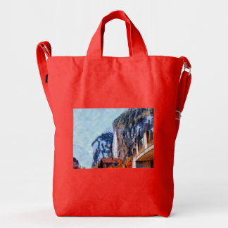 Towering cliffs and houses duck bag